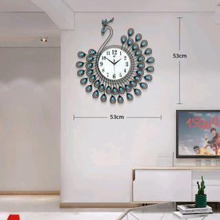 Đồng hồ treo tường con công 53x53cm giá sỉ